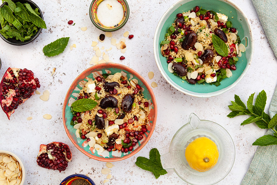 Couscous salad with colored giant beans and pomegranate