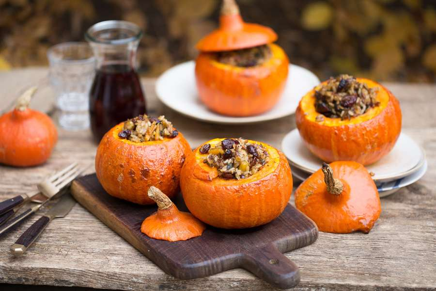 Roasted pumpkins stuffed with wild rice, pecan nuts and cranberries