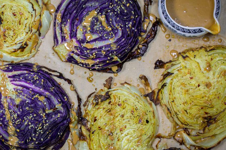 Roasted cabbage steaks with sesame seeds and orient dressing