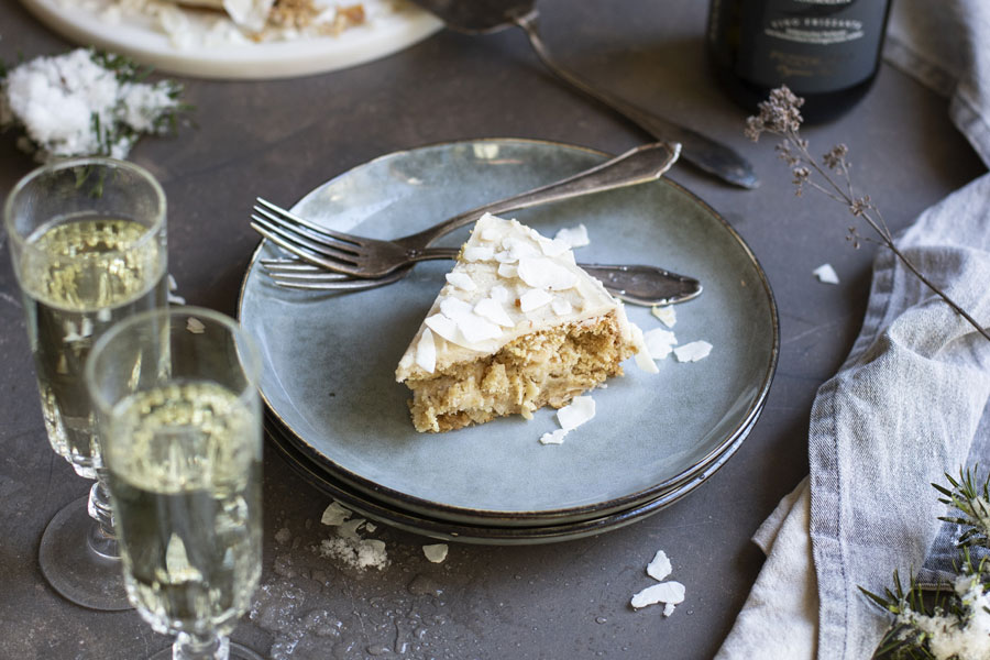 Coconut cake with coconut flakes and a coconut-almond cream
