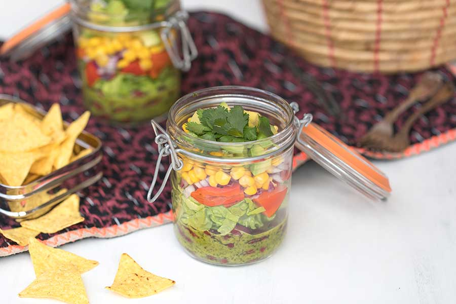 Mexican layer salad with coriander-lime dressing