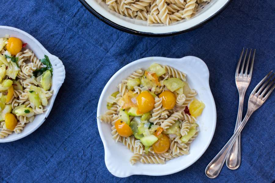 Spirelli with yellow cherry tomatoes, zucchini and fresh parsley