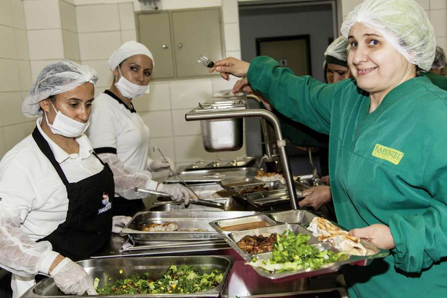 During the main season, the cafeteria prepares warm meals for nearly 300 employees